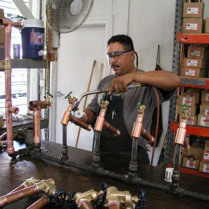 Can Am plumbing tech preparing kits at the warehouse